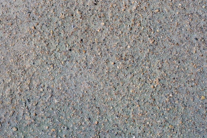 Grauer vulkanischer Sand und kleine Steinoberfläche Ausführlicher natürlicher Hintergrund oder Beschaffenheit lizenzfreie stockfotografie