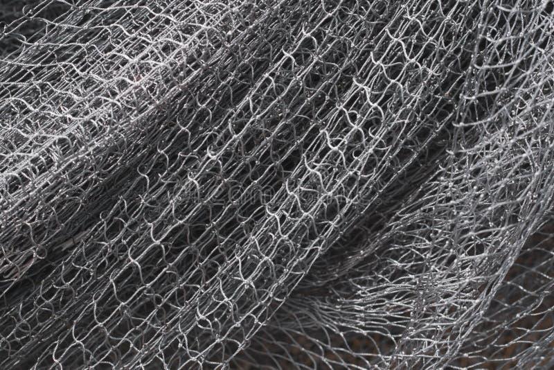 Graues Beschaffenheitsfischernetz Schließen Sie herauf Muster lizenzfreies stockfoto