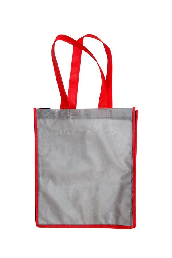 Graugewebe-Segeltuchtasche für den Einkauf lokalisiert auf weißem Hintergrund lizenzfreie stockfotos