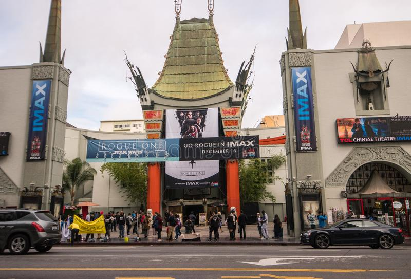 Grauman`s Chinese Theater in Hollywood, CA. Hollywood, California, December 9, 2016: Grauman`s TCL Chinese Theater on December 9 displaying signs advertising royalty free stock photo