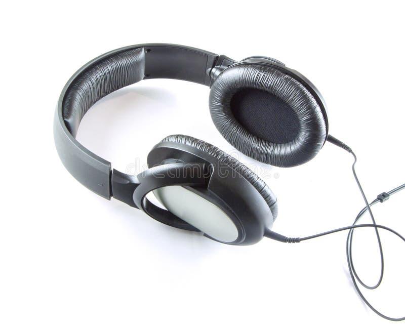 Grauwe hoofdtelefoon van de muziek met kabel die op een witte achtergrond wordt geïsoleerd royalty-vrije stock foto