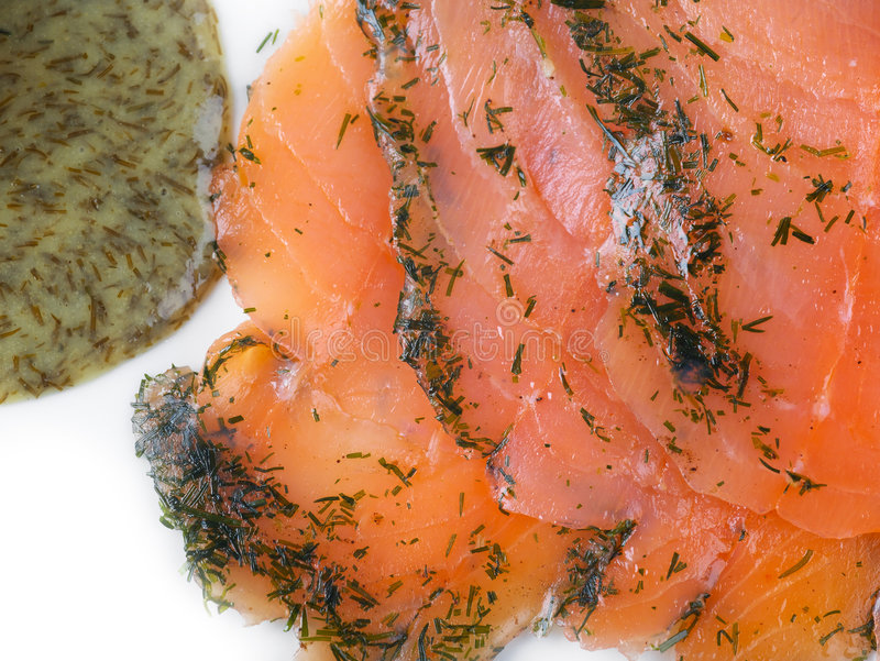 Gravadlax salmon with Dill Sau. Gravadlax, a cured salmon dish, with Dill sauce macro stock images