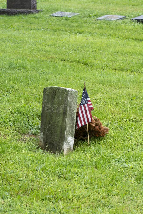 Grave with American flag decoration royalty free stock image