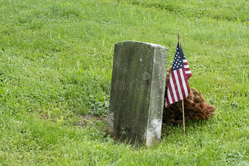Grave with American flag decoration stock photo