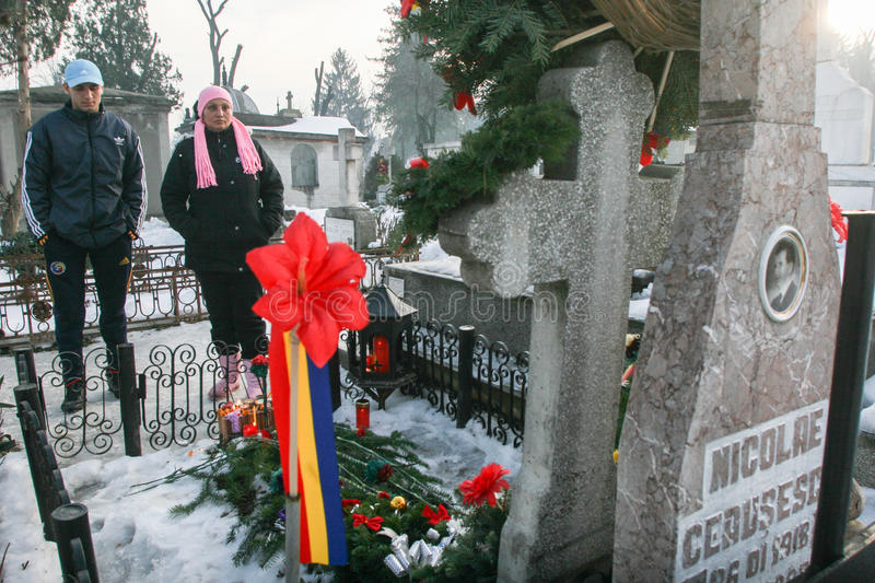 The grave of communist dictator Nicolae Ceausescu. Bucharest, Romania, December 25, 2009: People are praying at the grave of Romania`s late communist dictator stock images