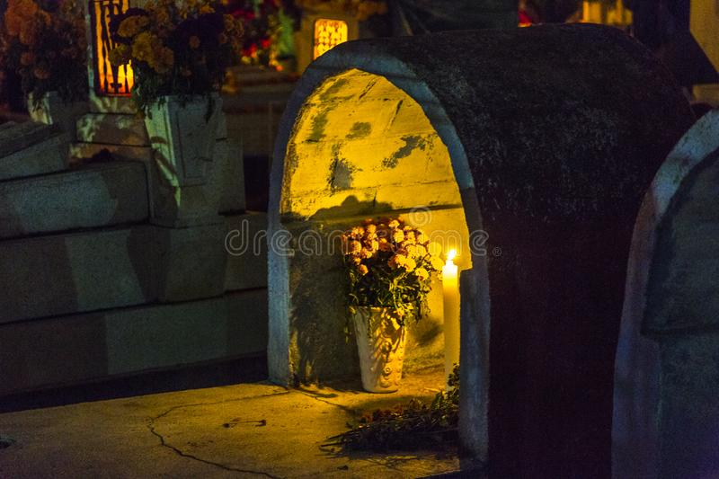 Grave Decoration During Day of the Dead. A grave is decorated with candles and flowers during the Day of the Dead celebrations in Oaxaca, Mexico royalty free stock photo