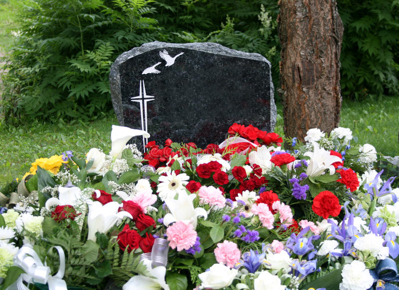 Grave with fresh flowers royalty free stock images