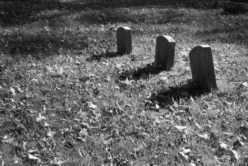 Grave Markers. Black and white image of three grave markers stock image