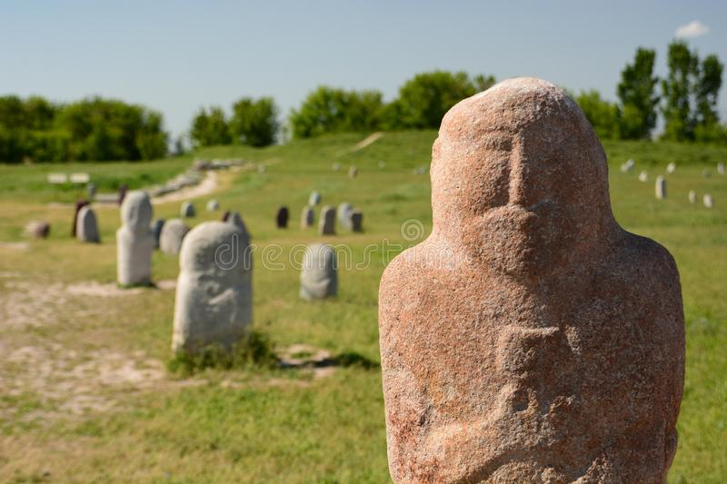 Grave markers in Burana tower archaeological site. Tokmok. Chuy Region. Kyrgyzstan. The Burana Tower is a large minaret in the Chuy Valley in northern Kyrgyzstan royalty free stock image