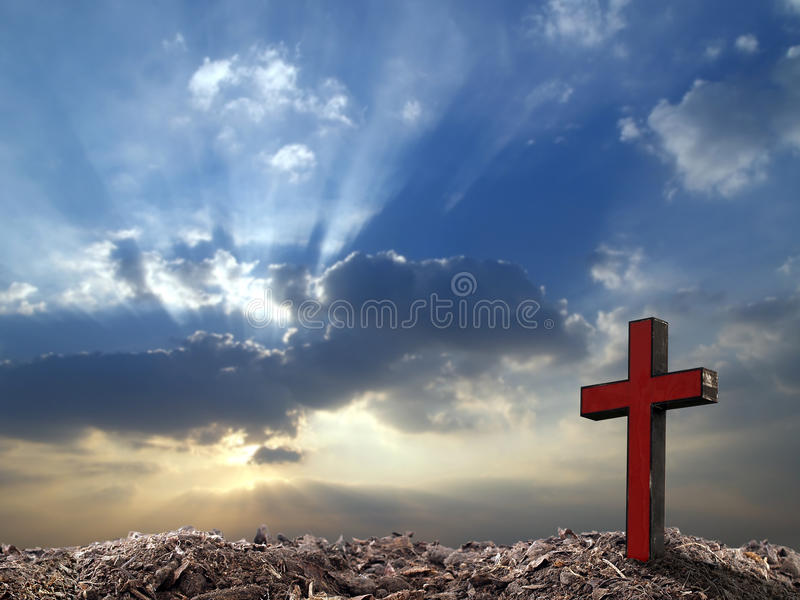 Grave, single old red wooden cross on hill top with sun light through clouds on dramatic sunrise sky background, good friday conce. Single old red wooden cross royalty free stock image