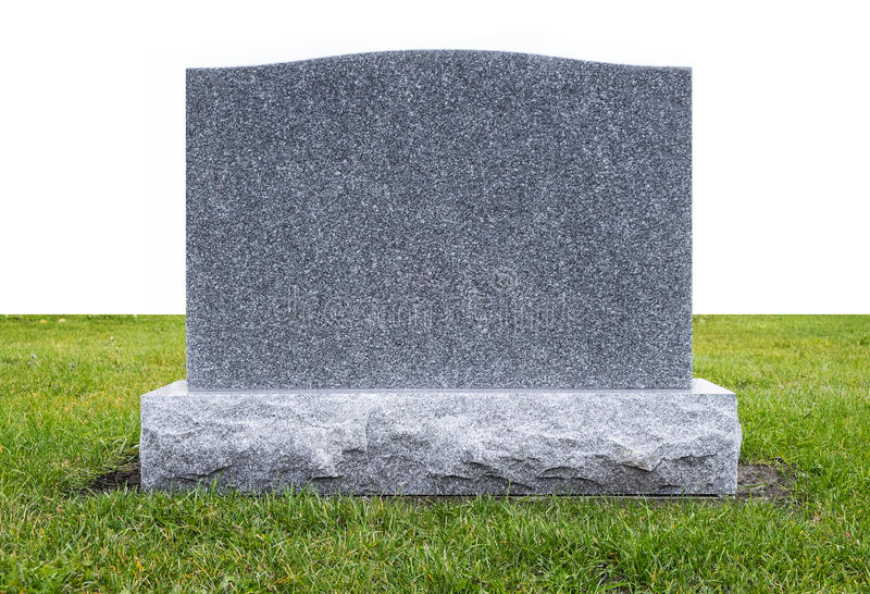 Grave Stone on Green Grass royalty free stock image