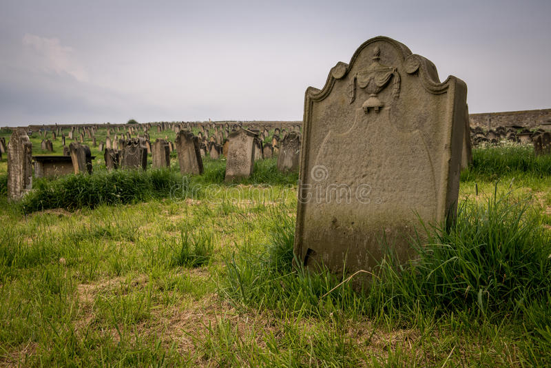 Grave stone at Whitby Abbey, England. Whitby Abbey is a ruined Benedictine abbey overlooking the North Sea on the East Cliff above Whitby in North Yorkshire stock image
