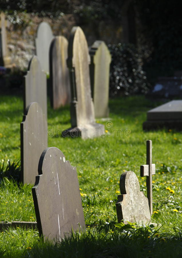 Grave yard. Old Grave yard with old grave head stones and cross royalty free stock image