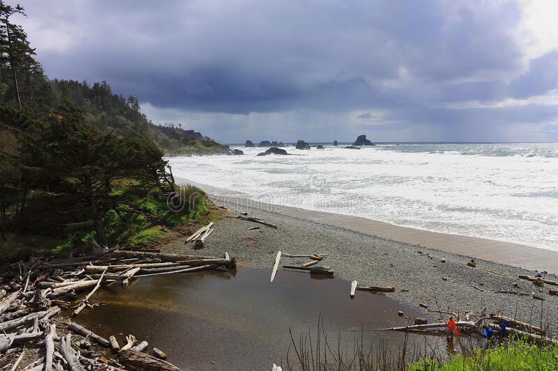 Stormy Day at Ecola State Park on the Oregon Coast, Pacific Northwest, Oregon, USA. Gravel beach and driftwood on a stormy spring day near Cannon Beach on the royalty free stock images