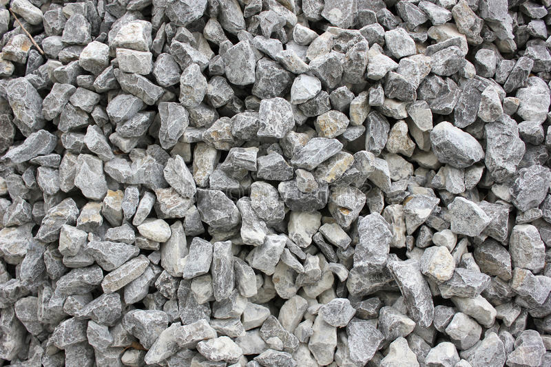 Gravel. Gray gravel for laying of asphalt roads and filling of emptiness stock photo