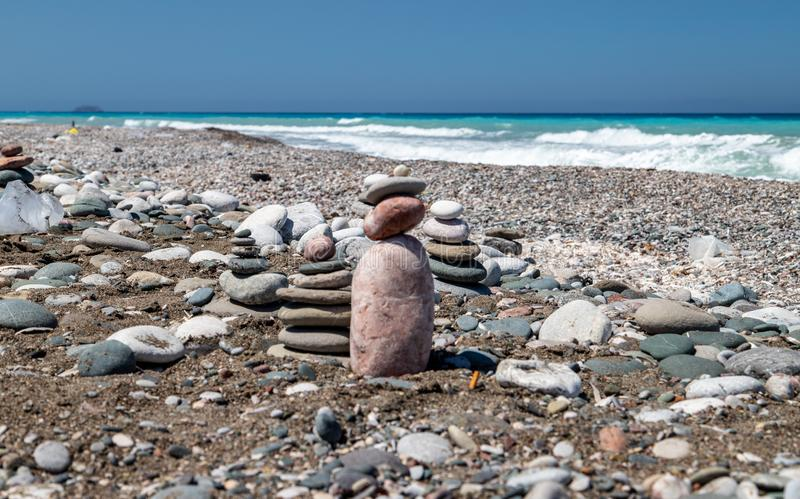 Gravel / pebble beach at the southwest coast of Rhodes island near Apolakkia with multi colored ocean water and small stone royalty free stock photo