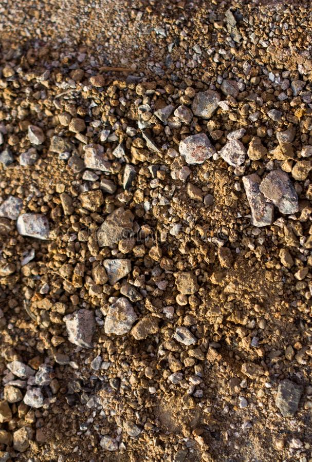 Gravel stones textured as abstract grunge background stock photography