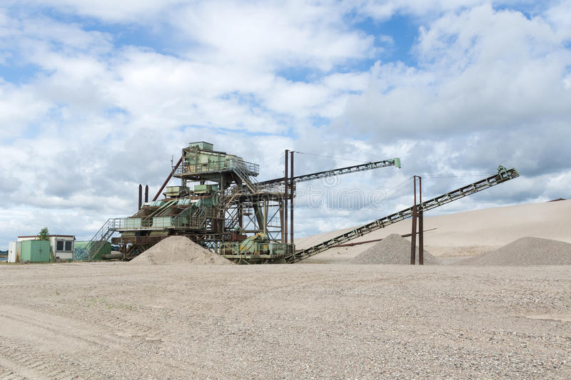 Gravel pit. Old Machine in the Gravel Pit stock photography