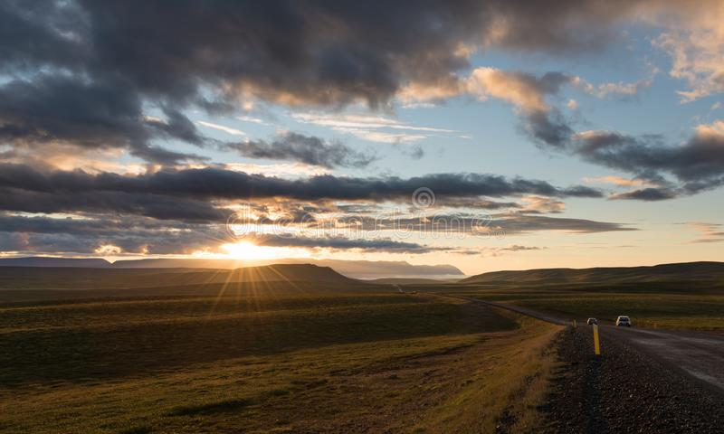 Gravel road along the valley at sunset royalty free stock image