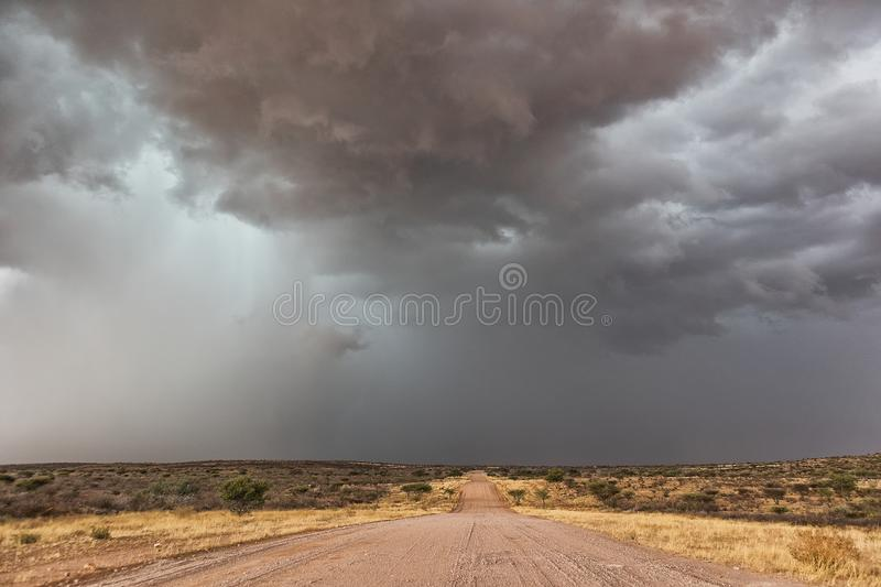Gravel road en route to the Namibian desert with extremely dramatic sky, storm. stock images