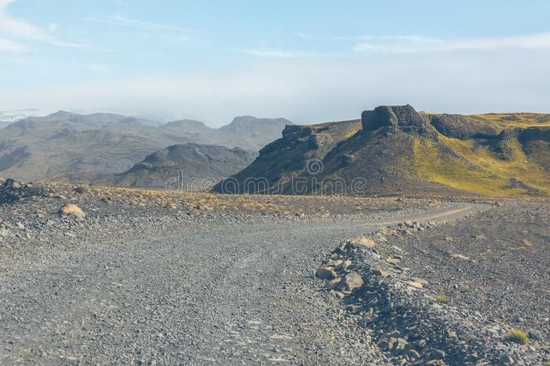 Gravel Road through Icelandic Lava mountains stock photography