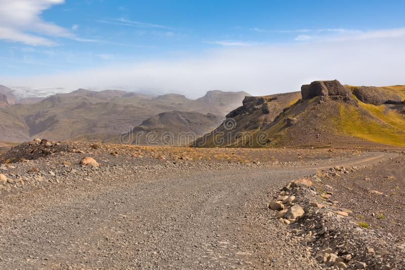 Gravel Road through Icelandic Lava mountains stock images