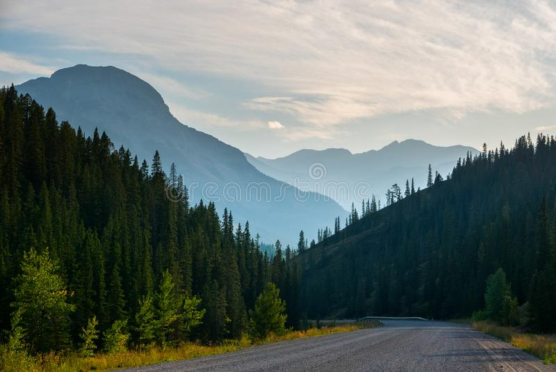 Gravel road in Kananaskis Country with haze from forest fires royalty free stock photo