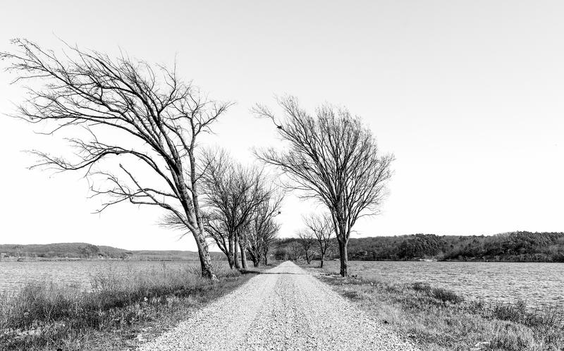 Gravel Road Through the Lake stock images