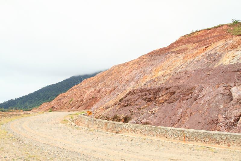 Gravel road on mountain stock photos