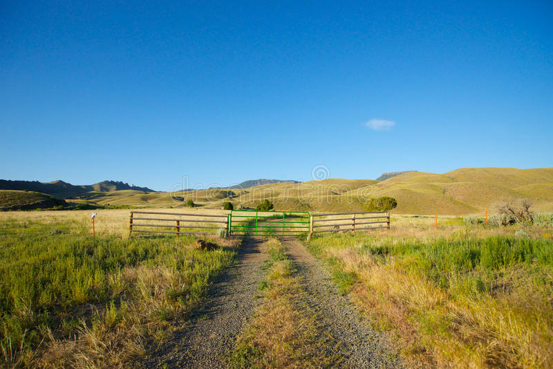 Gravel Road in Ranch Land. Gravel road leads through grassy ranch land in western Wyoming royalty free stock photos