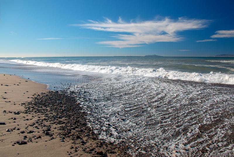 Gravel and Seafoam waves on beach at McGrath State Park in Ventura - Oxnard California USA. Gravel and Seafoam waves on beach at McGrath State Park in Ventura stock images