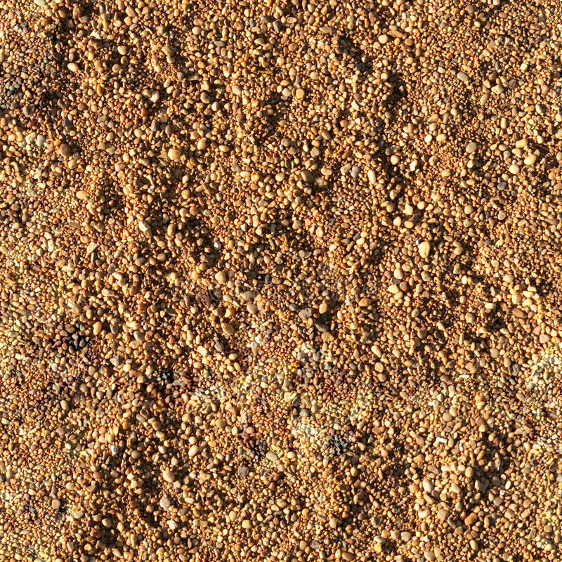 Gravel seamless texture. Gravel seamless tilable texture on riverbank royalty free stock image