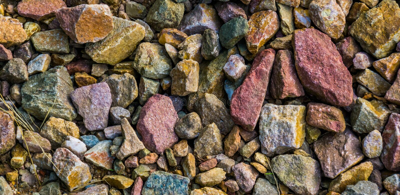 Gravel stones in diverse colors in closeup, stone pattern background. Many gravel stones in diverse colors in closeup, stone pattern background royalty free stock photos