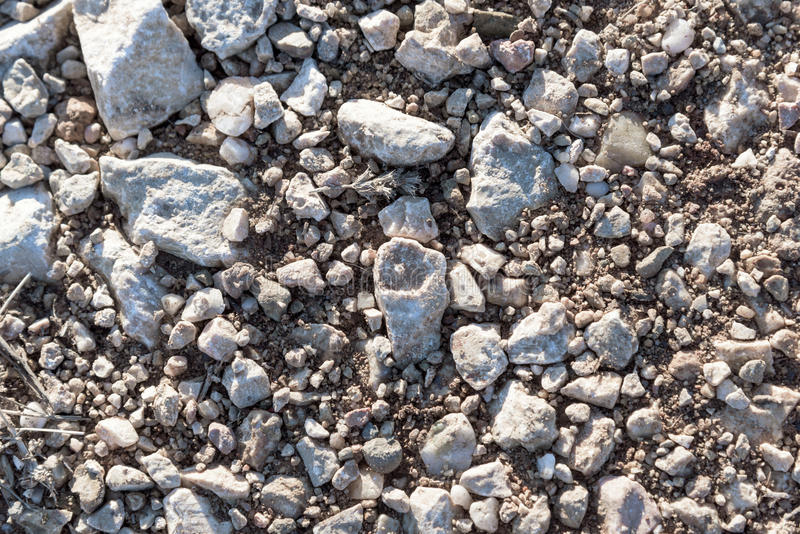 Gravel with strange stone in center stock images