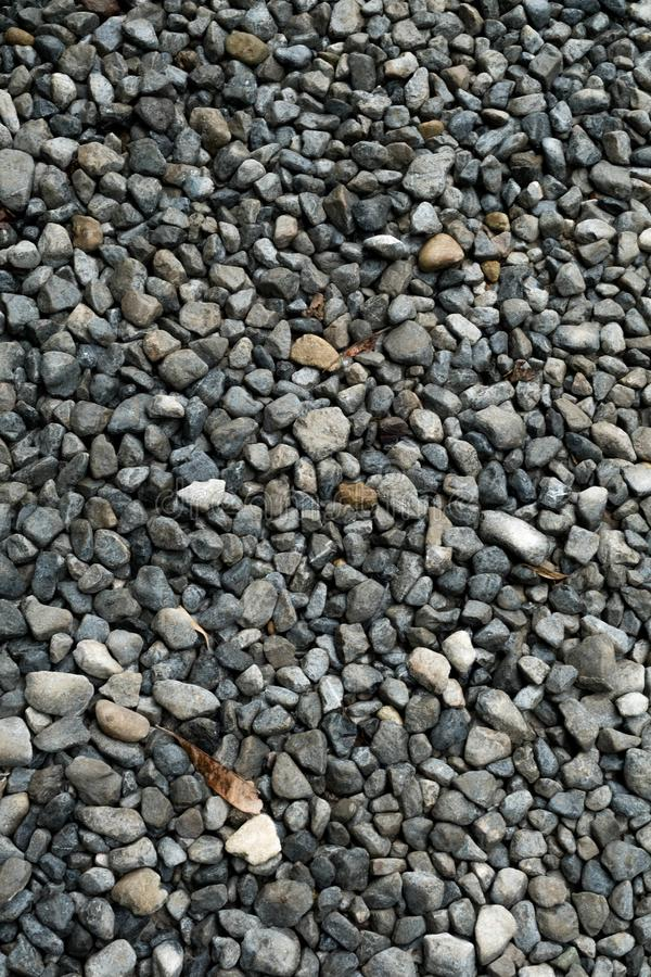 Gravel texture. Small stones, little rocks, pebbles in many shades of grey, white and blue. Texture of little rocks, background royalty free stock image