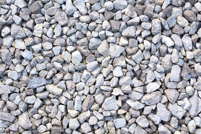 Gravel texture. Small stones, little rocks, pebbles in many shades of grey, white and blue. Texture of little rocks. stock photo