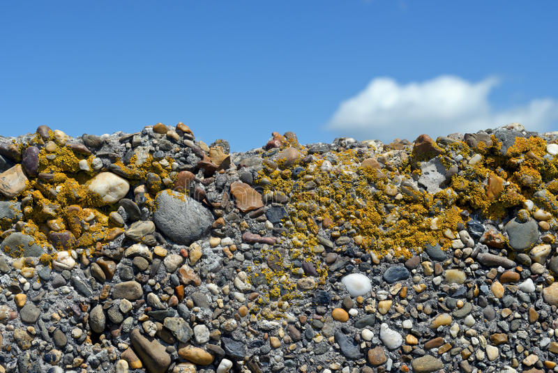 Gravel wall with blue sky