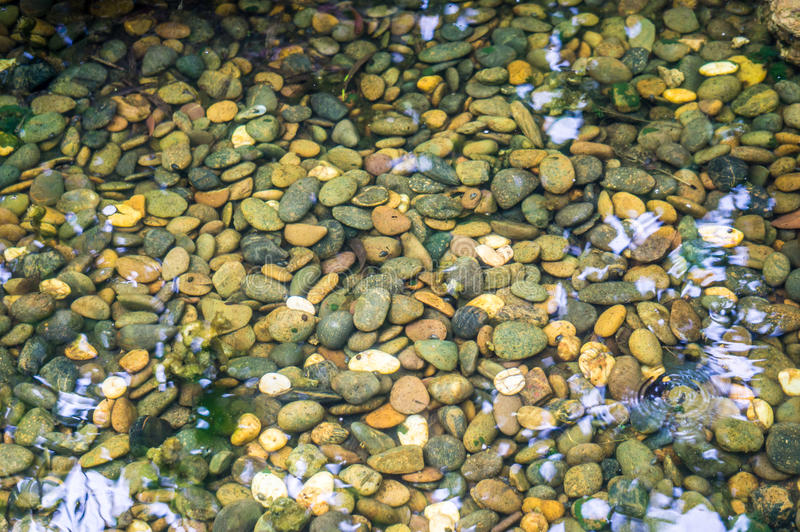 Gravel in water. royalty free stock photography