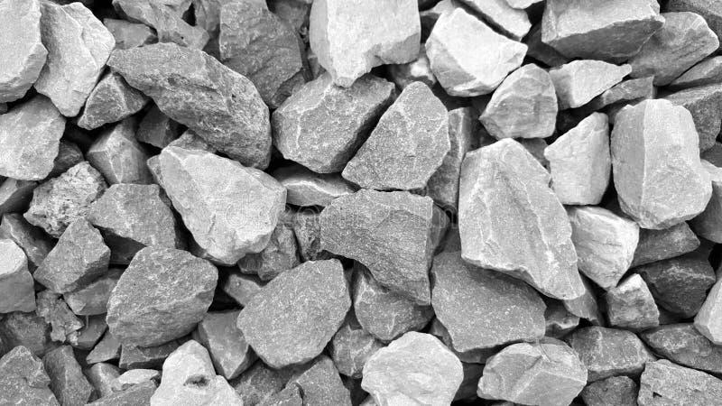 Gravelez la texture ou le modèle de surface approximative avec de petites pierres, noires et blanches photographie stock libre de droits
