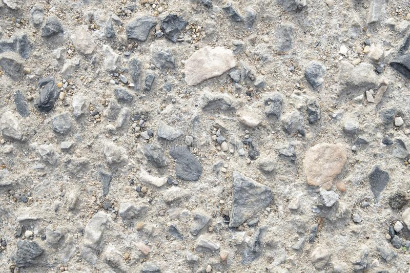 Gravels background. Large and small gravels background.  Abstract and textured surface background, dirt, dust, shape, objects, sandy, beige, grained, colored royalty free stock images