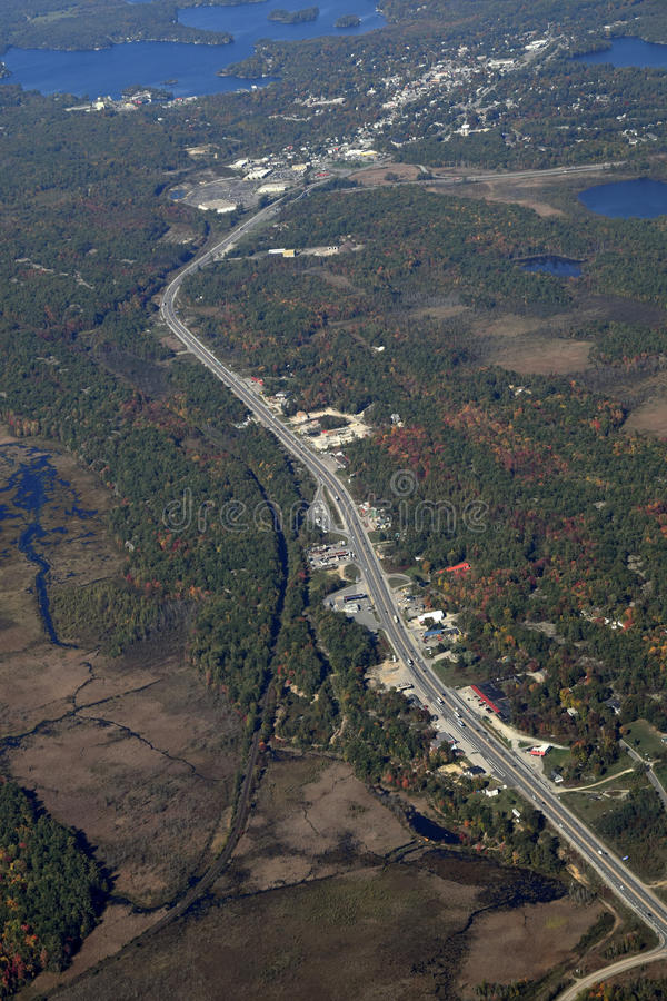 Gravenhurst highway Ontario, aerial. Autumn aerial view of a highway leading north to Gravenhurst at lake Muskoka, Ontario Canada stock image