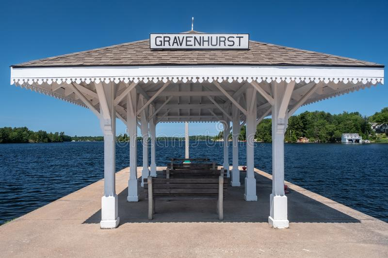 Gravenhurst Wharf, Lake Muskoka. On Lake Muskoka, at the end of the wharf in Gravenhurst, Ontario, a shelter stands for passengers waiting to board historic stock photography