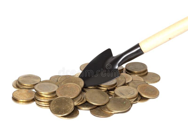 Graver een gouden muntstuk, zaken royalty-vrije stock afbeeldingen