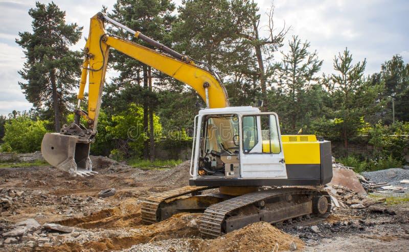 Graver op bouwwerf stock foto