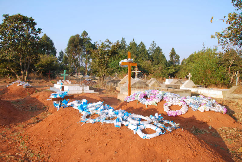 The graves of the cemetery of the village Pomerini Tanzania, Afr. The cemetery of the village Pomerini where are buried many children affected by the virus HIV stock photos