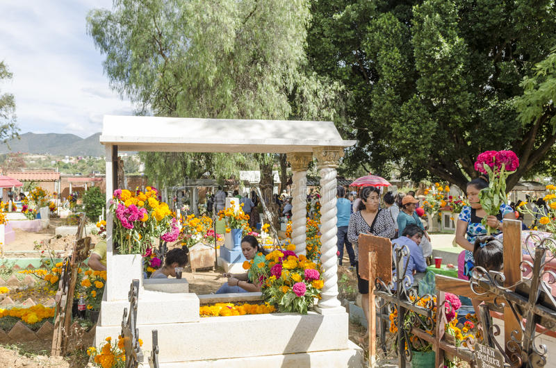 Graves decorated with flowers. OAXACA, OAXACA, MEXICO - NOVEMBER 2, 2016: Graves decorated with flowers at the Oaxaca General Cemetery in Oaxaca City, México stock photo