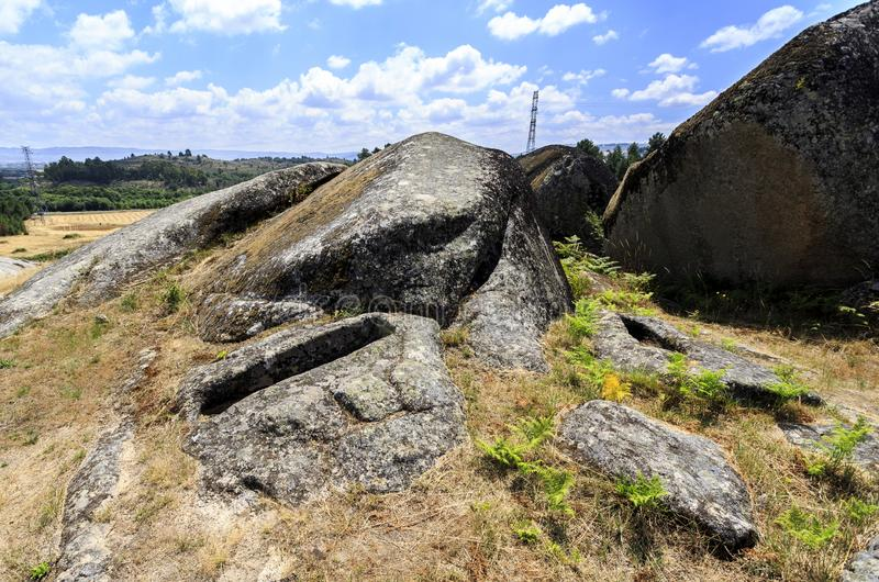 Graves of the St Gens Necropolis. View of a granite rock cut non-anthropomorphic grave at the St Gens Necropolis Site near Celorico da Beira, Beira Alta stock photography