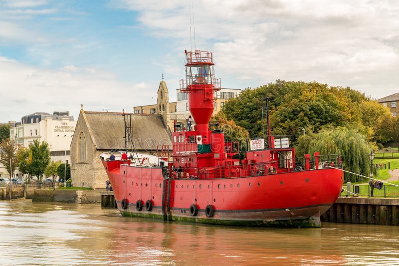 Gravesend, Kent, England, UK. September 23, 2017: View at the shore of the River Thames with LV21 an old lightship transformed into a floating art space stock photography