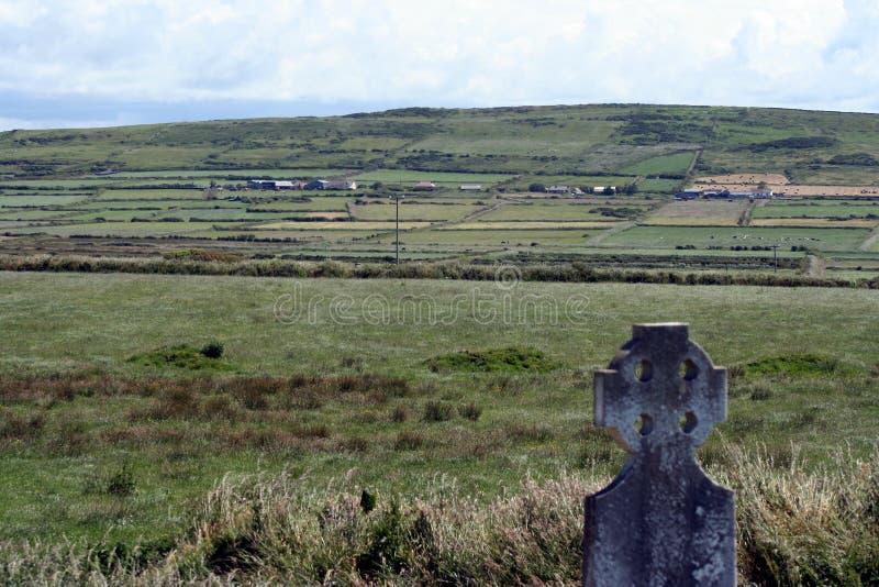 Gravestone overlooks Ireland royalty free stock photos