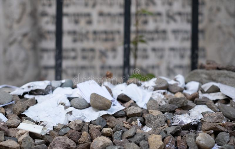 Gravestone of famous rabbi at Remuh / Remah Cemetery on Szeroka Street in Kazimierz, historic Jewish quarter of Krakow, Poland. Gravestone of Rabbi Moses royalty free stock photography